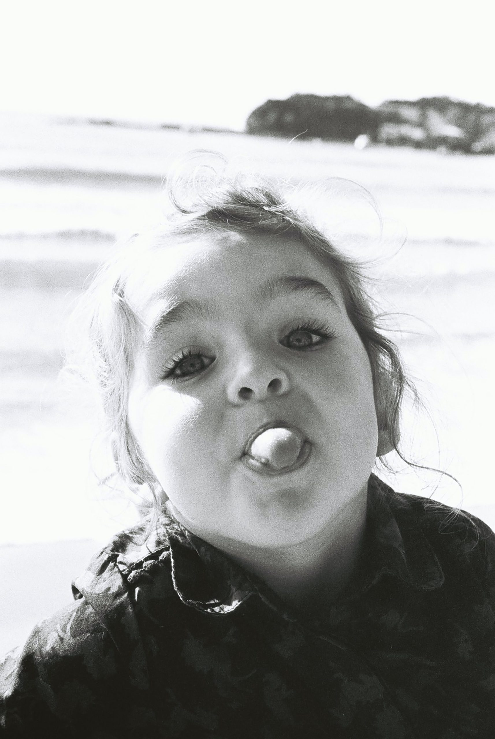 A young girl sticking her tongue out as she understands her characteristics as a Highly Sensitive Person.