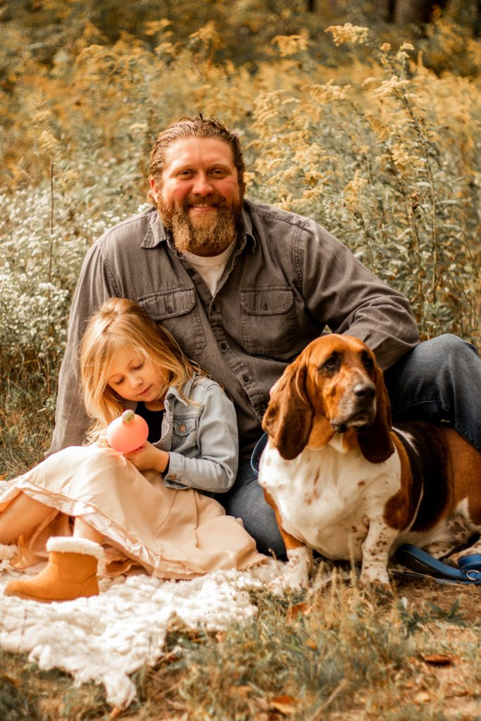 Chill looking man with daughter and hound, appearing to be interested in learning more about his wife with High Sensitivity