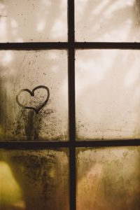 A foggy window with a small heart on it represents that it is hard to love someone with anxiety and depression, and how important it is to stay healthy