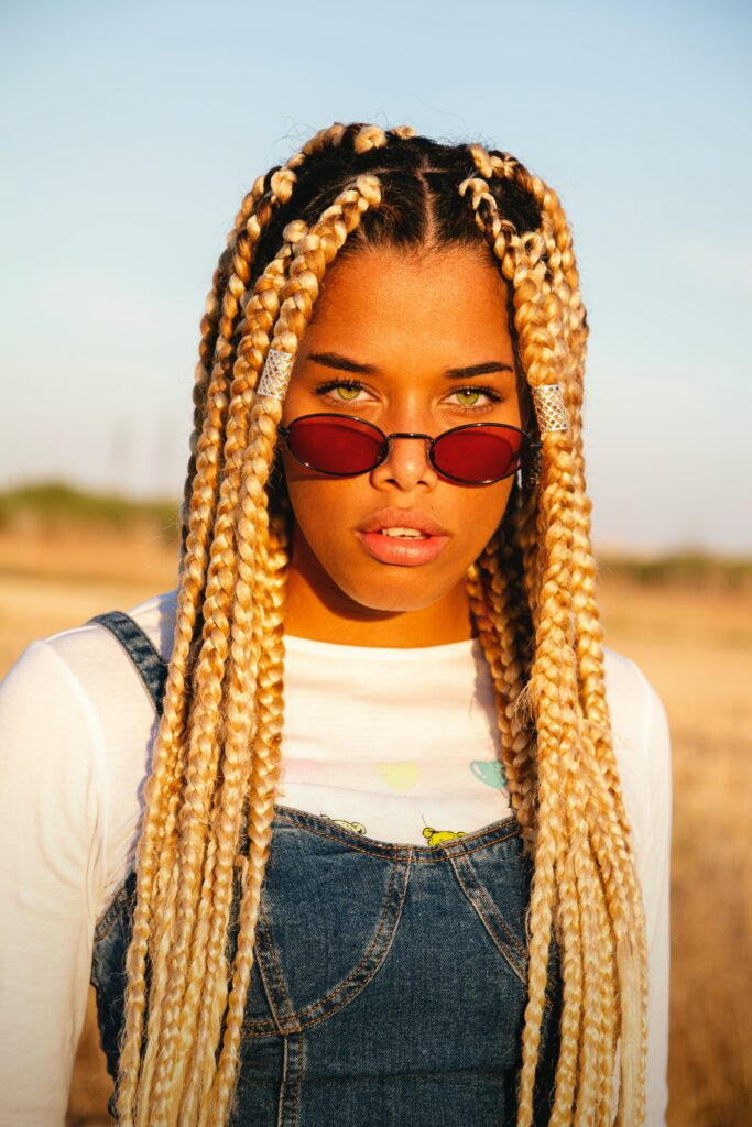 An image of a girl African American girl with sunglasses.