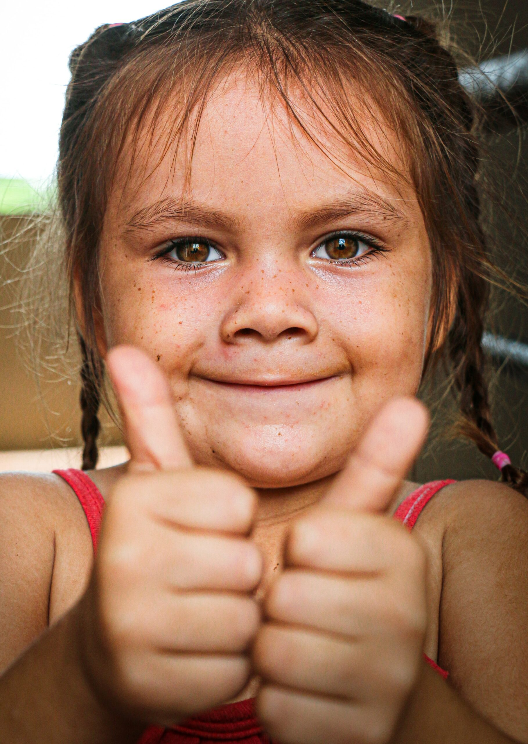 A photo of a girl with two thumbs up as if she likes or loves her body